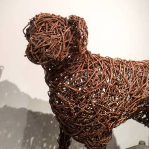 A life sized willow dog sculpture