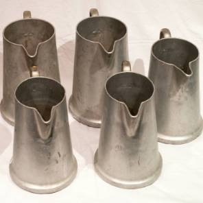Set of Eight Silver Jugs